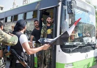 بدء عملية نقل مسلحين ومدنيين من بلدات في ريف دمشق وادلب و اطلاق سراح 19 اسيراً من مسلحي المعارضة