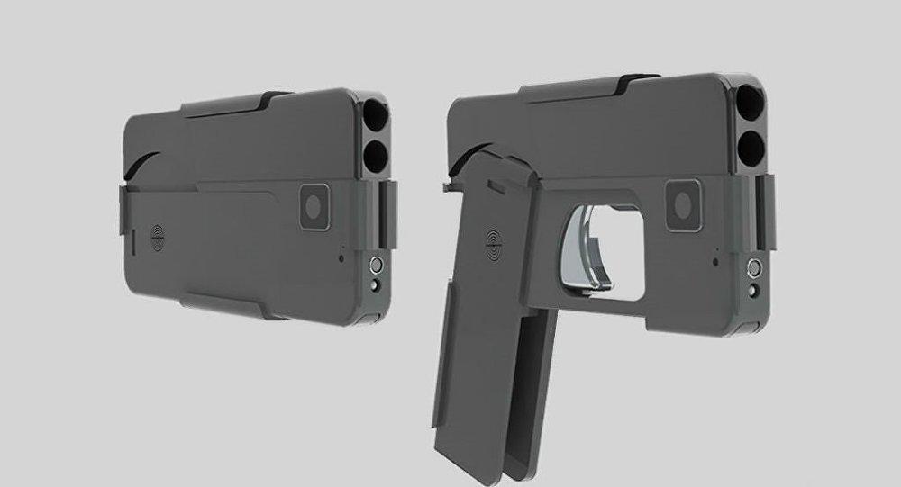 بالصورة.. مسدس أمريكي في هيئة هاتف محمول