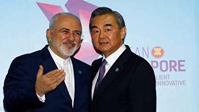 وزير الخارجية الصيني: سنواصل التعاون مع إيران