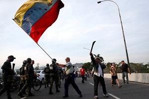 إسبانيا: نعارض أي انقلاب عسكير في فنزويلا وندعو لإجراء انتخابات