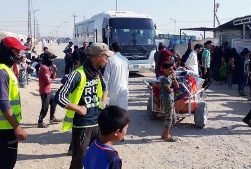 وزارة النقل تعلن إعادة 920 نازحاً الى مناطق سكناهم