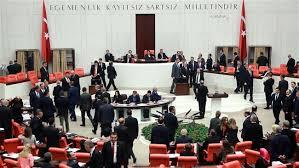 Fighting erupts in Turkish parliament over Erdogan powers bill