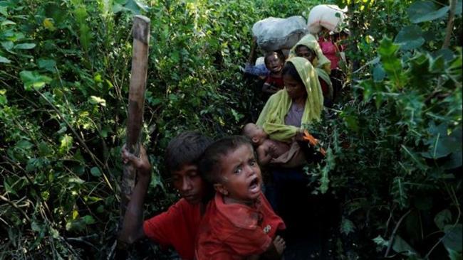 Dozens of Rohingya drowned en route to Bangladesh, 12,000 more flee