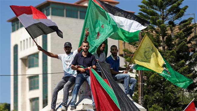 Israel threat won't deter Hamas, Fatah from unity efforts: PA