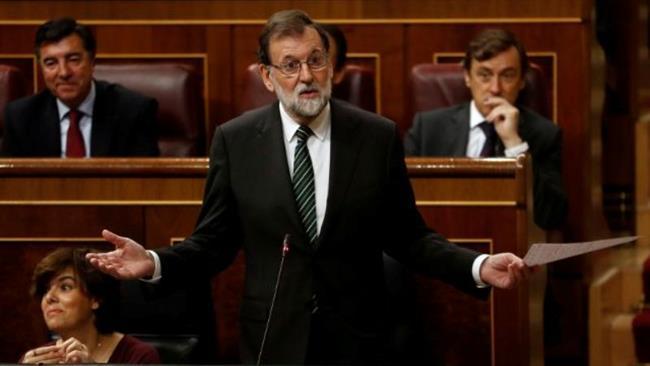 Spain PM warns Catalan president to drop secession bid