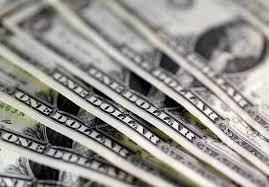 Dollar edges up ahead of Fed decision; kiwi jumps on strong jobs data