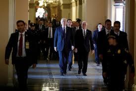 Senate Republicans shove tax bill ahead as Democrats fume