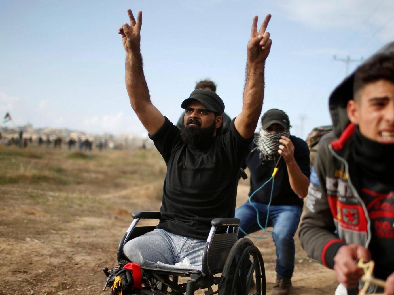 Disabled Palestinian activist shot dead by Israeli troops in Jerusalem al-Quds protest