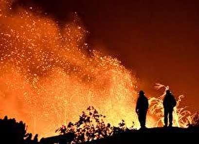Break in winds helps California battle historic wildfire