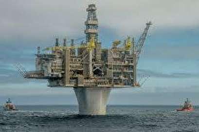 Oil near June 2015 high as production cuts tighten market