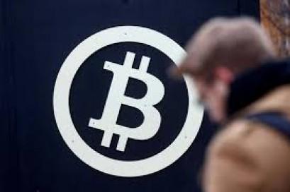 Bitcoin plummets more than 12 percent to below $15,000