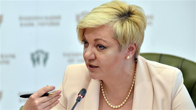 Ukraine's central bank chief resigns amid praise, threats