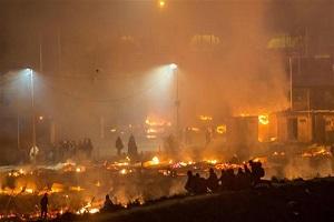 Huge fire destroys refugee camp in northern France after clashes