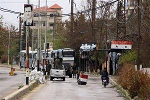 Civilians, militants begin evacuating 4 Syria towns
