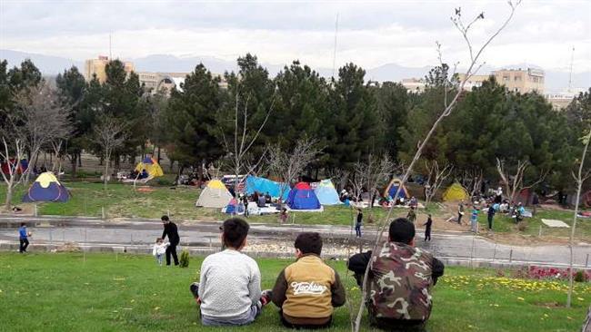 Iranians marking Sizdah Bedar by going outdoors