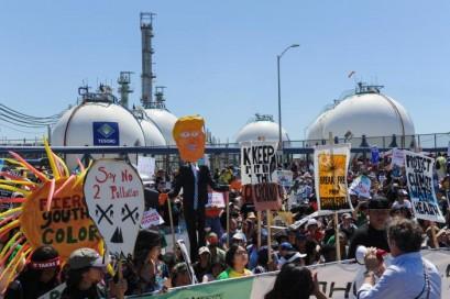 Environmental protesters swarm outside White House as Trump hits milestone