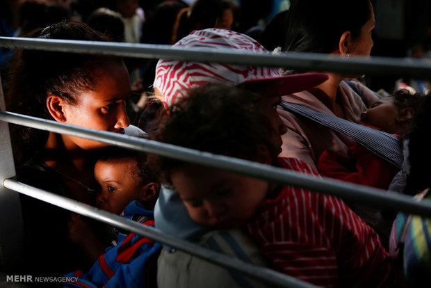 Venezuelans queue for food and basic goods.