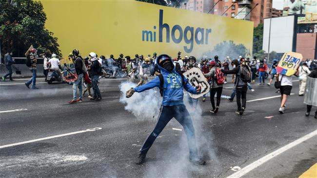 Fresh protests rock Venezuela after man set on fire