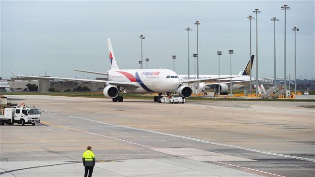 Malaysian plane returns to airport after false bomb threat