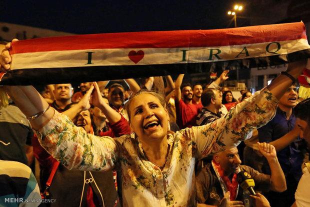 Iraqis celebrating victory in Mosul