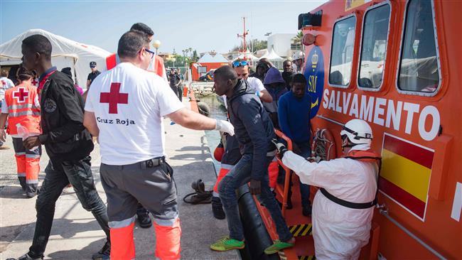 Nearly 70 migrants hurt crossing Spanish border