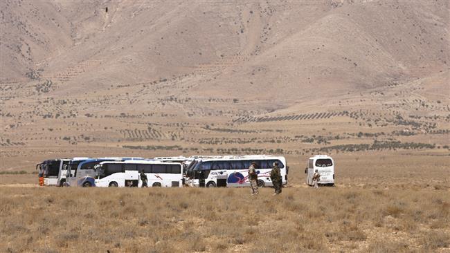 Daesh terrorists, their families begin evacuating Syria-Lebanon border zone
