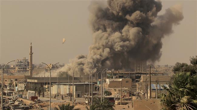 Dozen Syrian civilians die in fresh US-led airstrikes on Raqqah