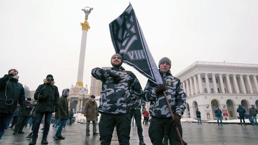 Hundreds of far-right vigilantes sworn in to 'enforce Ukrainian order' on Kiev's streets