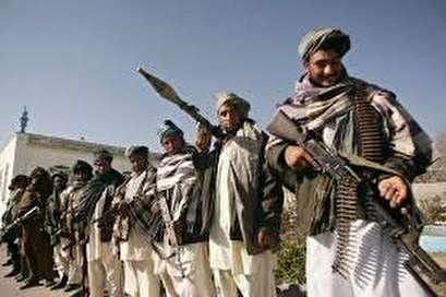 Taliban target NATO convoy, killing 2 Afghan civilians