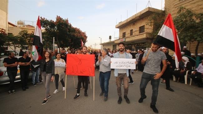 Syrians in occupied Golan burn Israeli election ballots, protest judaization
