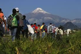 Caravan migrants arrive in Mexico City