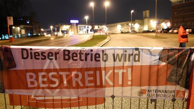German industrial workers stage third day of strike