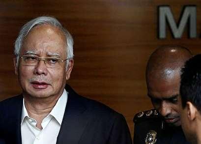 Malaysia's Najib explains why he had so many luxury handbags, lots of cash, jewelry