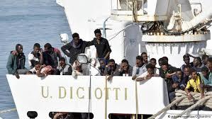 Opening door to migrants, some Italians defy government line