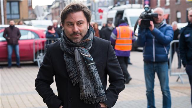 Belgium arrests TV presenter over armed robbery
