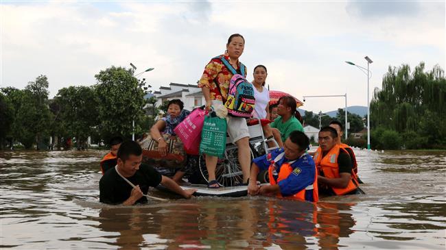 China evacuates 127,000 as heavy rains lash Guangdong