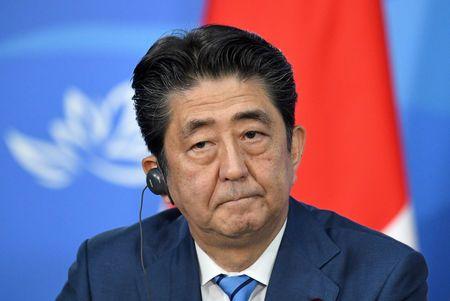 Japan PM Abe says arranging visit to China next month