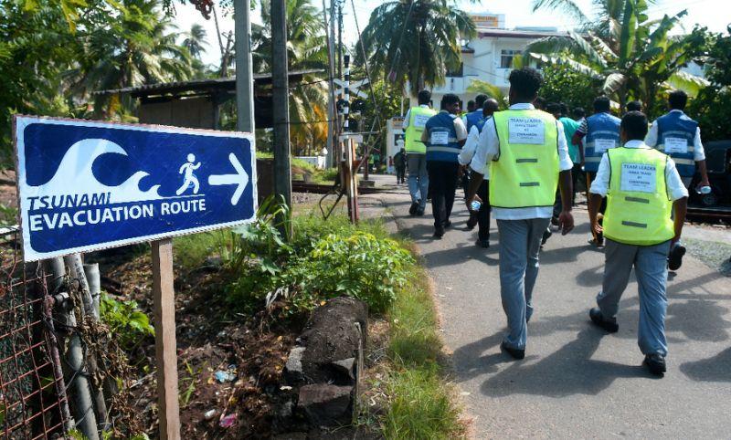 Indonesians flee to higher ground in regional tsunami drill