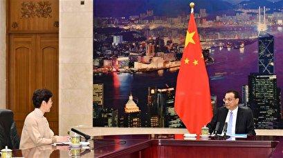 Fresh violence breaks out in Hong Kong as Lam holds talks in Beijing