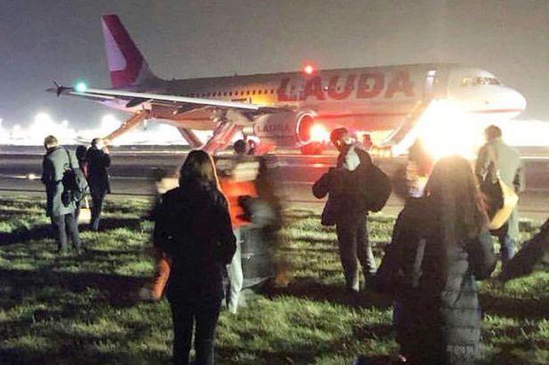 'huge bang' leads plane to abort take-off, 8 injured