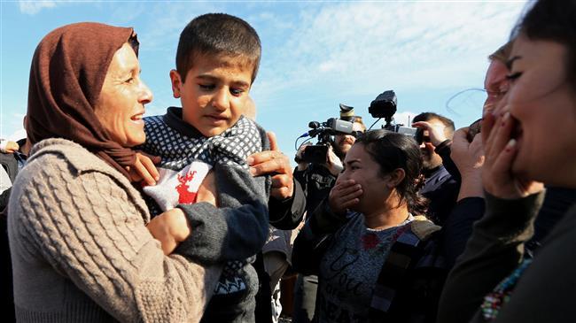 Freed Izadi women, children reunite with families in northern Iraq