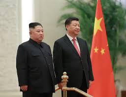 North Korea's Kim meets China's Xi, says awaiting US actions