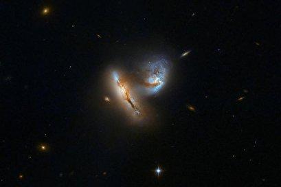 Hubble photographs playful galactic duo