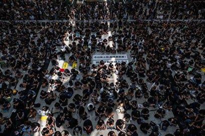 Beijing 'preparing tanks at Hong Kong border', warns Trump as protesters clash with police at airport