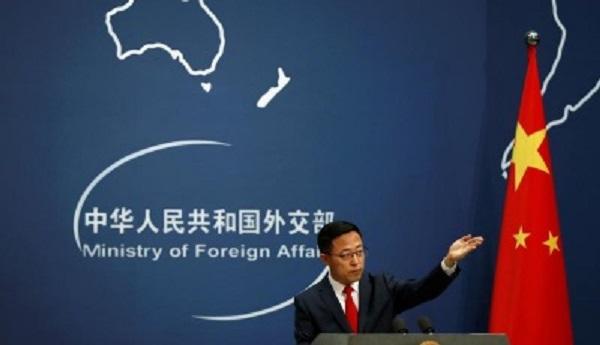 China denies report it may detain Americans, says U.S. mistreats its scholars
