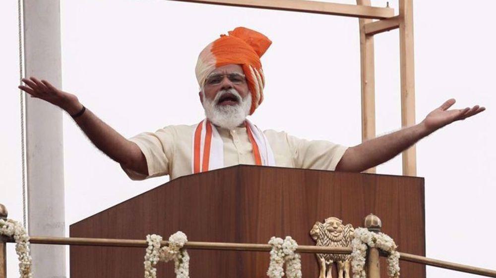 India's Modi visits iconic temple in New Delhi amid mass farmer protests