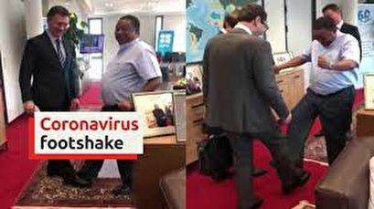 Avoiding hugs, OPEC officials greet with their feet amid virus outbreak