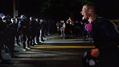 Clashes in Portland erupt again, US police make 11 arrests