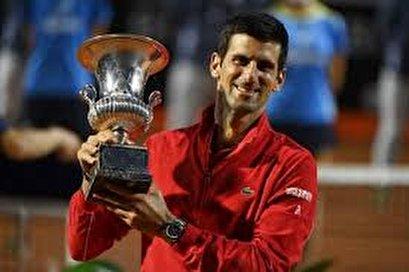 Italian Open: Djokovic wins title to make Masters history