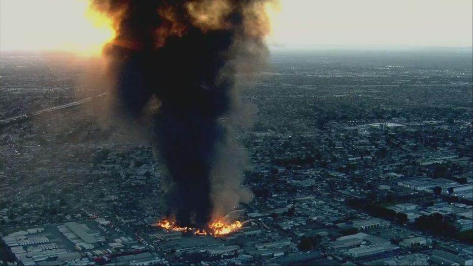 Massive fire burns in industrial area of Compton